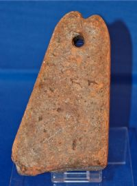 A large and heavy 16th Century red terracotta fishermans net weight. SOLD